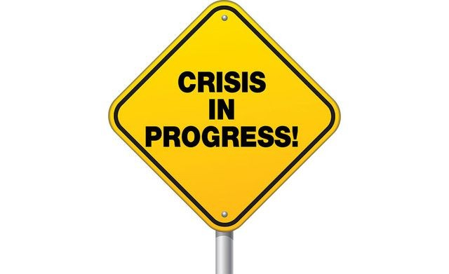crisis-in-progress-sign